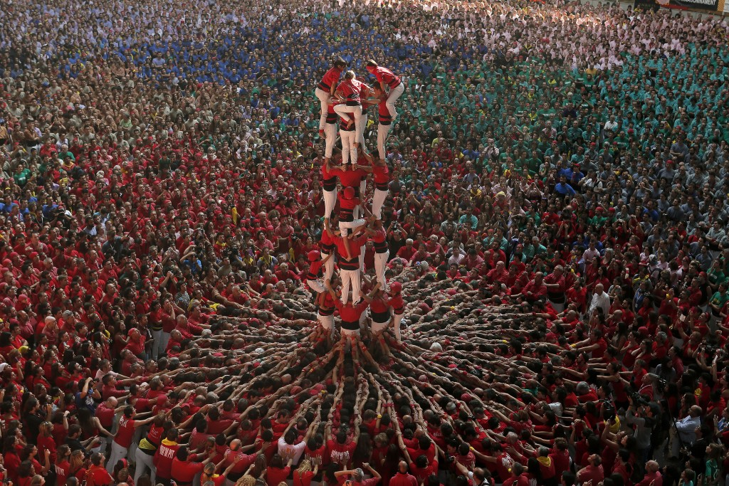 TARRAGONA, SPAIN - OCTOBER 05: The best castellers of Spain gather for the 25th edition of the 'Competition Castells', considered 'The world largets casteller show' has been performed at the Tarraco Arena Plaza, the great castellera appointment calls the best every two years in Tarragona, Spain, on Sunday, October 5, 2014. A total of 30 groups will take part in this action, a record, the result of the impetus given by the organization, which has decided to extend the contest two days. This is the only action that has a competitive format, unlike the character display of traditional festivals where it is anticipated that about 25,000 people pass through the Tarraco Arena Plaza during the two days 'Competition Castells'. (Photo by Hugo Ortuño)