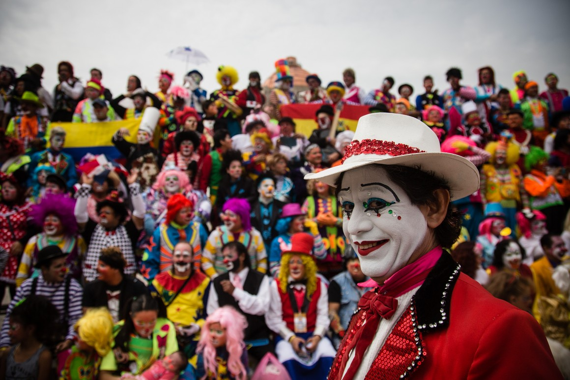 MEXICO CITY, MEXICO - OCTOBER 21: Clowns attend the panoramic photo taken at the Monumento a la Revolucion in Mexico City. This year marked the twentieth Fair Laugh, clown convention, which come from all over America, including Peru, El Salvador, Honduras, Guatemala, Ecuador, Nicaragua, United States and Mexico. In Mexico City, Mexico on October 21, 2015. (Photo: Manuel Velasquez/Anadolu News Agency)