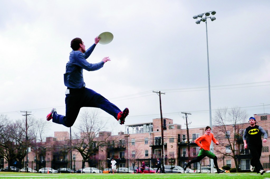 Gabe Webster, left, leaps into the air to catch a pass during tryouts for the D.C. Breeze, a new ultimate Frisbee professional team, at Woodland Tiger Field in Washington, D.C., February 16, 2013. (Preston Keres/MCT)